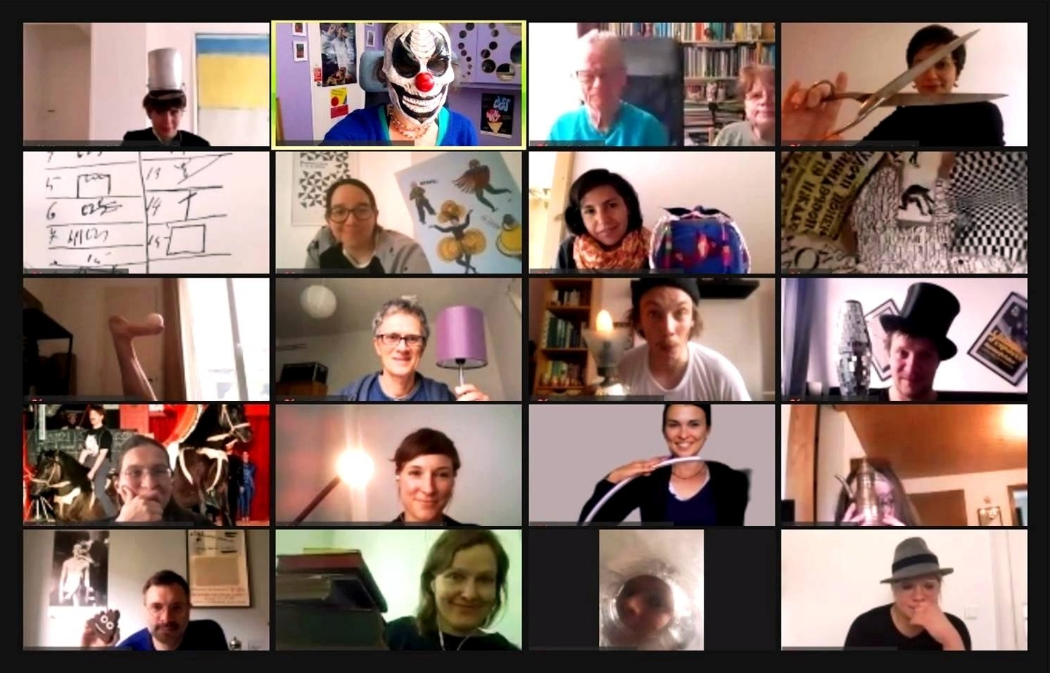 Some of the participants of the virtual symposium showing what they associate with their research/projects at the intersections between science and art (2020). Screenshot: Anna-Sophie Jürgens.